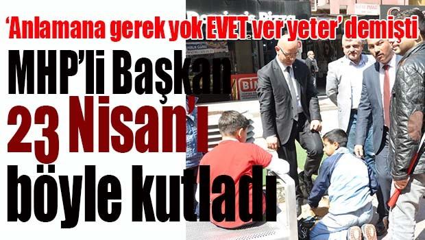 MHP'li Başkan 23 Nisan'ı çocuğa ayakkabı boyatarak kutladı
